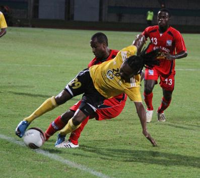 T&TEC striker Bevon Bass, centre, chases after the ball between the Neal & Massy Caledonia AIA duo of Nuru Abdullah Muhammad, left, and Radanfah Abu Bakr during their Lucozade Sport Goal Shield semifinal at the Mannie Ramjohn Stadium, Marabella on Friday night. Caledonia won 3-1. Photo: Rishi Ragoonath.