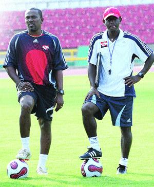 Dynamic duo reunite: Trinidad & Tobago head coach Russell Latapy, right, and his new assistant coach Marvellous Marvin Faustin take charge of national team training at the Hasely Crawford Stadium yesterday. (Photo Credit: T&T Express).