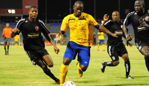 Defence Force striker Devon Jorsling (center) vs Ma Pau