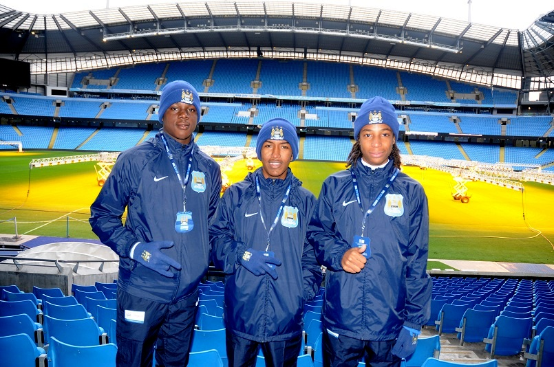 Elijah Shade, John-Paul Rochford (centre), and Tyrell Emmanuel at Manchester City's Etihad Stadium.