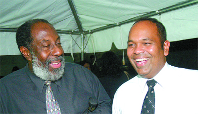 Richard Groden, left, pictured with Om Lalla in an undated photo. (T&T Newsday)