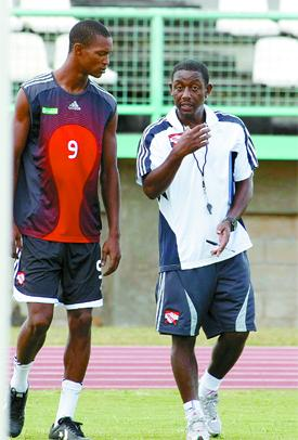 San Juan Jabloteh, midfielder, Ataullah Guerra, left, listens attentively to some words of advice from Soca Warriors coach, Russell Latapy during a national team training exercise at the Larry Gomes Stadium, Malabar, yesterday. Photo: Anthony Harris