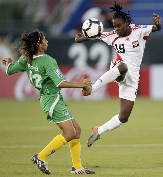 Kennya Cordner of Trinidad and Tobago (R) jumps for the ball with Katrina Moore of Guyana during the CONCACAF Women's World Cup qualifying soccer match at the Beto Avila stadium in Cancun November 2, 2010.