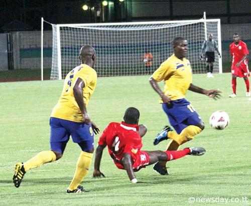 THAT'S St Ann's Rangers defender Elijah Belgrave making a high tackle on Defence Force striker Kevon Carter, right, which resulted in a broken leg for the Army-Coast Guard man. At left is Defence Force striker Devon Jorsling. Action was at the Mannie Ramjohn Stadium, Marabella, in the First Citizens Cup match. ...Author: ANIL RAMPERSAD