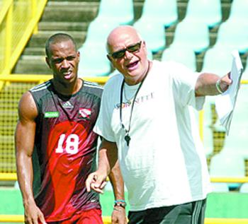 Densill Theobald and coach Otto Pfister.