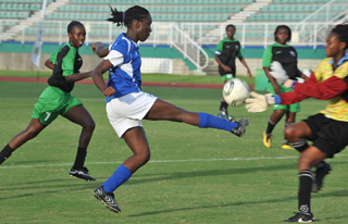 WHAT A BLOCK!: Roxborough Secondary goalkeeper Shanice Sylvester, right, does well to keep out this shot from Debe Secondary midfielder Amanda Theodore in Monday's BG T&T/First Citizens Secondary Schools Football League