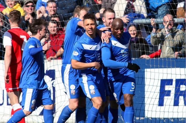Marvin Andrews celebrating with teammates after scoring a goal