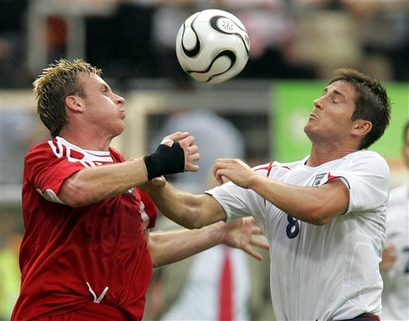 Chris Birchall goes up against England's Frank Lampard.