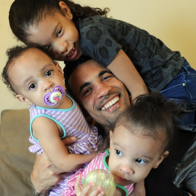 Ipswich Town captain Carlos Edwards gets his training in with his three girls, twins Makayla and Makenzie, one, and Melanie, six.