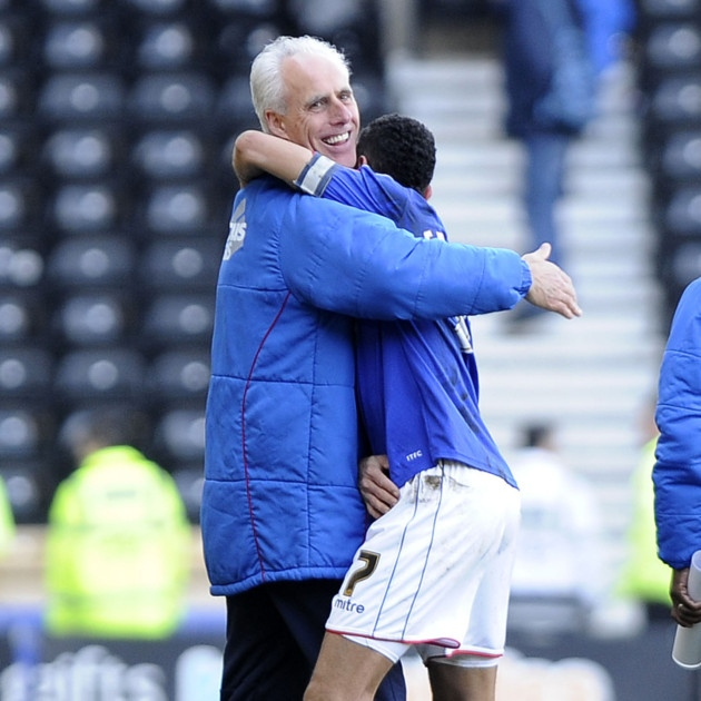 Mick McCarthy embraces Carlos Edwards after his match-winning strike at Derby