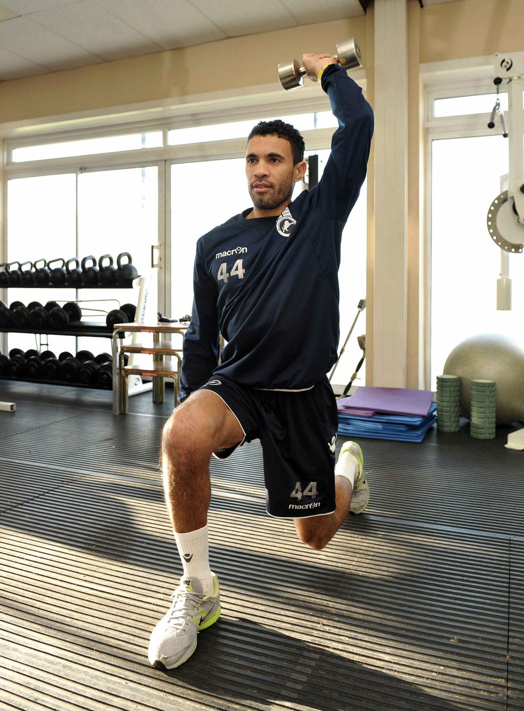 Carlos Edwards in the gym rehabilitating his knees