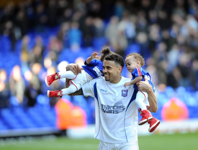 Carlos Edwards does a lap of honour with his young twins, who were born prematurely during his time at Ipswich Town
