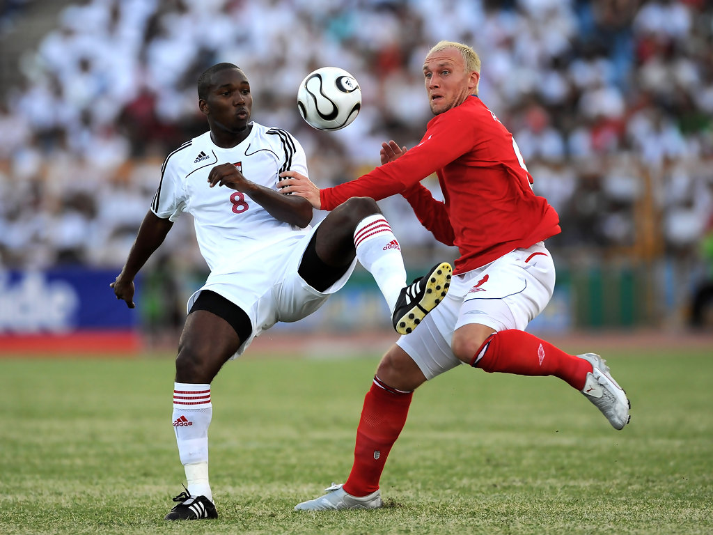Dean Ashton of England is challenged by Khaleem Hyland of Trinidad during international friendly between Trinidad & Tobago and England at the Hasely Crawford Stadium on June 1, 2008 in Port of Spain, Trinidad.