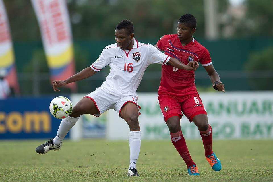 Ricardo John (#16) attempts to control the ball while under pressure from Fidel Escobar (#6) during a CONCACAF U-20 Championship match between Panama and T&T at Montego Bay Sports Complex, Montego Bay, Jamaica on Sunday, January 18th 2015.