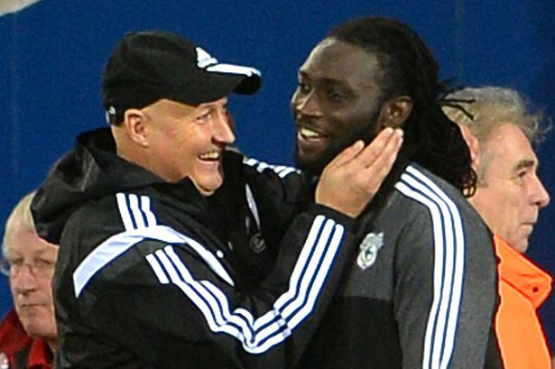 Kenwyne Jones and Cardiff City manager Russell Slade