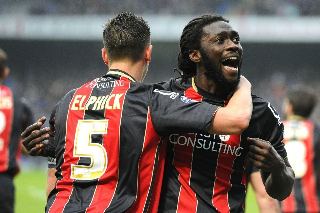 Kenwyne Jones celebrates with teammates after scoring AFC Bournemouth's equalizer during an English Championship match against Ipswich Town at Portman Road, Ipswich, England on Friday, April 3rd 2015.