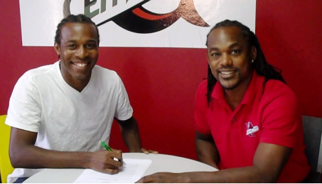Central F.C. CEO, Brent Sancho, sees his latest addition, Yohance Marshall put pen to paper.