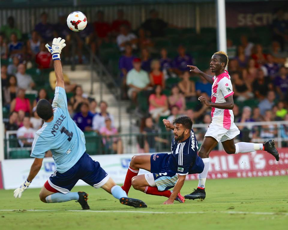 Kevin Molino scores with a cheeky chip against Harrisburg City Islanders on August 16th 2014.
