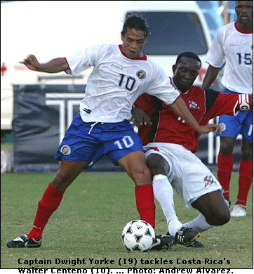Costa Rica's Walter Centeno up against Dwight Yorke