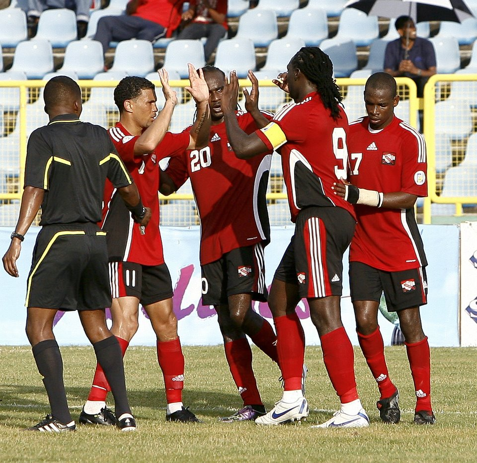 T&T players celebrate against Bermuda