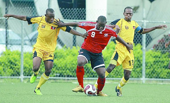 Soca Warriors striker, Devon Jorsling, centre, fends off the challenge from two Antigua & Barbuda players during their international friendly at the Marvin Lee Stadium, Macoya, July 11. T&T won 4-1. Photo: Anthony Harris