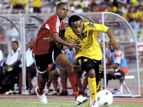 T&T youngster Jovin Jones man marking Dane Richards. (PHOTO CREDIT: - Jamaica Gleaner).
