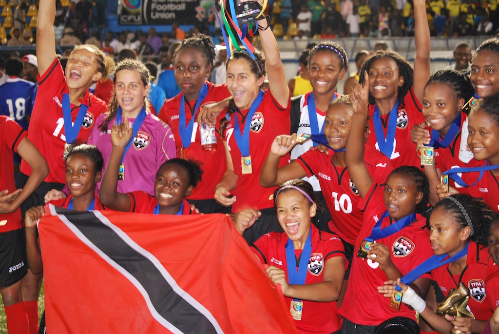 T&T Women's U17 Team members proudly display their national flag.