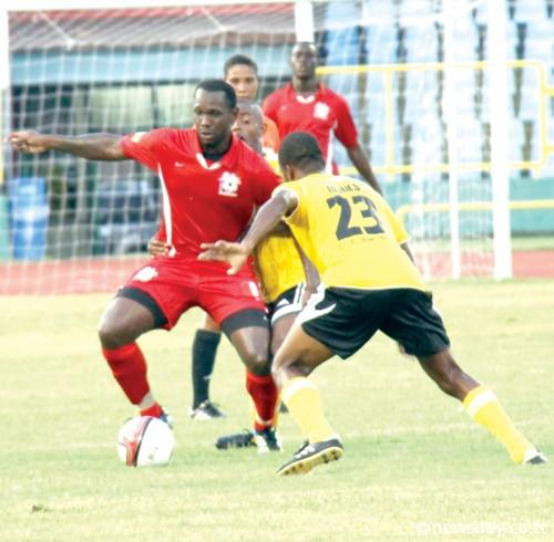 ST ANN'S Rangers forward Errol Mc Farlane Jr, left, attempts to dribble past T&TEC'sKevin Modeste, right, in their First Citizens Cup match at the Hasely Crawford Stadium,Mucurapo on Friday. ...Author: SUREASH CHOLAI