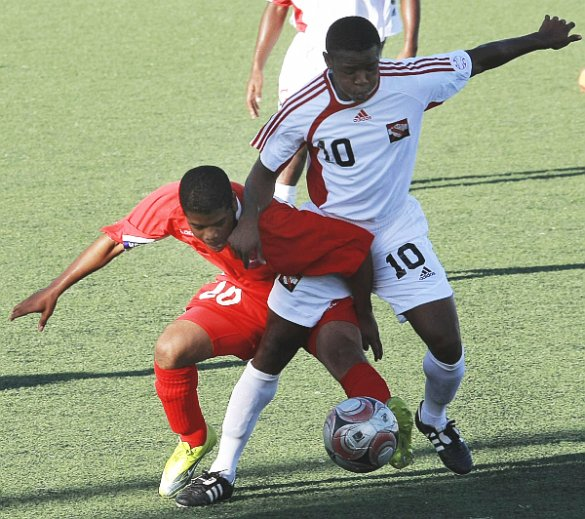 Bermuda's Frank Garcia, left, battles for the ball with T&T midfielder Jomal Williams in their Caribbean Football Union Group E qualifier at the Marvin Lee Stadium, Macoya, yesterday. Williams scored a pair in T&T's 2-1 win. Photo: Anthony Harris.