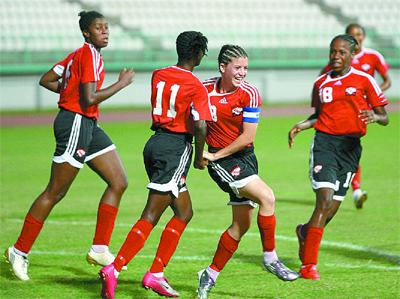 Soca Princesses' captain, Anique Walker, centre celebrates with team-mates as another goal is scored against Dominica in their CFU Under-17 Group B qualifier at the Larry Gomes Stadium, Malabar on Wednesday.Photo: Anthony Harris