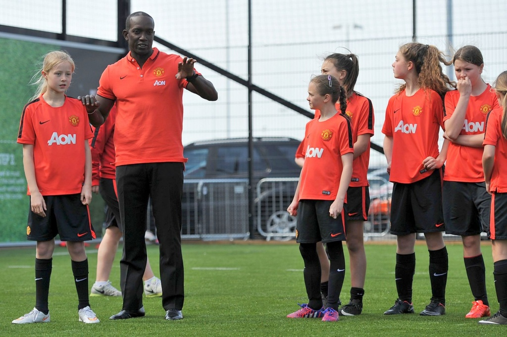 Dwight Yorke during a skills session with some of Manchester United young female players on the Apollo kick pitch at Old Trafford.