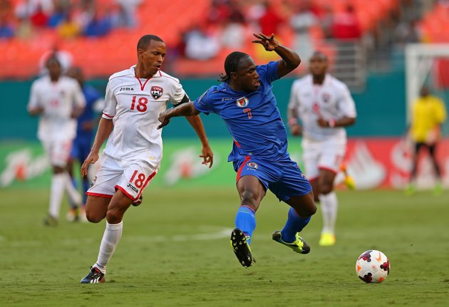 theobald-vs-haitiMIAMI GARDENS, FL - JULY 12: Jeff Louis #7 of Haiti fights for the ball with Densil Theobald #18 of Trinidad & Tobago during a CONCACAF Gold Cup game at Sun Life Stadium on July 12, 2013 in Miami Gardens, Florida. (Photo by Mike Ehrmann/Getty Images)