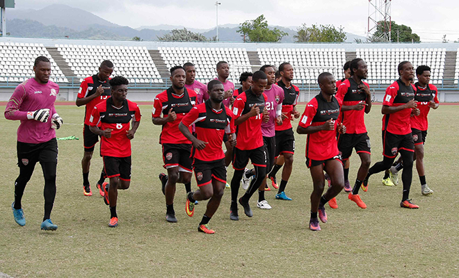 Members of the T&T football squad work out during a training session at the Larry Gomes Stadium in Malabar Arima yesterday