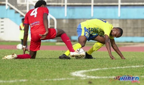 Photo: Defence Force midfielder Aaron Lester (right) tries to keep possession under pressure from Morvant Caledonia defender Otev Lawrence during Pro League action at the Hasely Crawford Stadium on 25 January 2020. (Copyright Daniel Prentice/CA-Images/Wired868)
