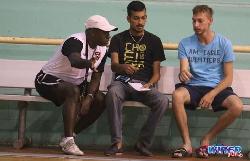Photo: Then Trinidad and Tobago National Futsal Team coach Clayton Morris (left) gesticulates during an interview with Wired868 reporter Amiel Mohammed (centre) at the Maloney Indoor Sport Arena in March 2016.   ...(Courtesy Chevaughn Christopher/CA-images/Wired868)