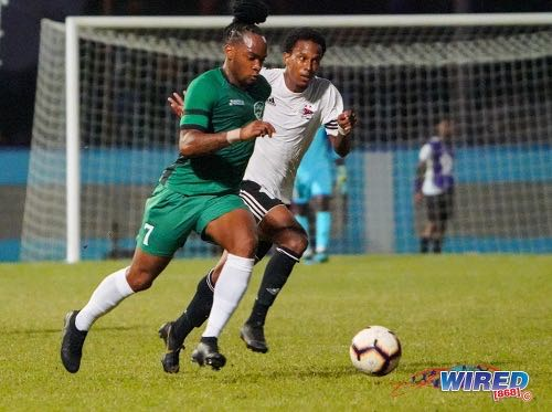 Photo: W Connection attacker Neil Benjamin Jr (left) steams past Central FC attacker Sean Bonval during Pro League action at the Ato Boldon Stadium in 12 February 2020. Benjamin scored from the penalty spot as Connection won 4-1. (Copyright Daniel Prentice/Wired868)