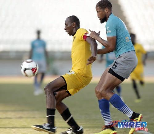 Photo: Cunupia FC forward Kevon 'Showtime' Woodley (left) holds off Morvant Caledonia AIA defender Radanfah Abu Bakr during Ascension action at the Larry Gomes Stadium on 14 September 2019. (Copyright Annalicia Caruth/Wired868)
