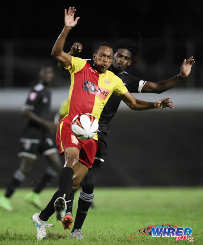 Photo: North East Stars midfielder Densill Theobald (left) holds off Central FC attacker Jason Marcano during Pro League action at the Arima Velodrome on Friday 8 September, 2017. (Courtesy Allan V Crane/CA-Images/Wired868)