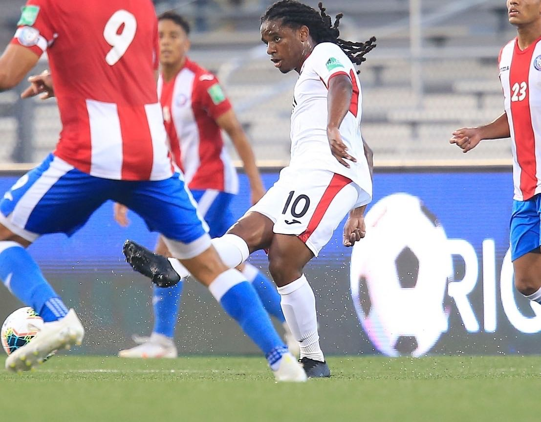 Photo: Trinidad and Tobago midfielder Duane Muckette (centre) looks for a teammate during World Cup qualifying action against Puerto Rico at the Estadio Centroamericano in Mayaguez on 28 March 2021. (via TTFA Media)