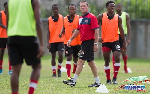 Photo: Trinidad and Tobago National Senior Team head coach Terry Fenwick (centre) guides his team during practice at the Police Barracks in St James on 3 July 2020. (Copyright Allan V Crane/CA-Images/Wired868)