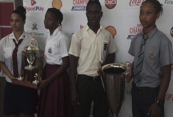 CAPTAINS ON SHOW: From left to right, Ria Dos Santos (Bishop's Anstey), Latiffa Pascall (Pleasantville), Renaldo Boyce (San Juan North) and Juda Garcia (Shiva Boys) occupy centre stage at the InterCol Finals launch yesterday at Hasely Crawford Stadium.