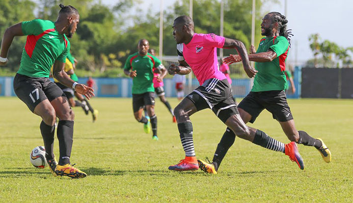 San Juan Jabloteh defender Josiah Trimmingham (L) and midfielder Keyon Edwards (R) tries to stop Central FC attacker Rundell Winchester during the 2016/17 Digicel Pro League.