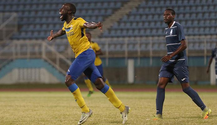 ​Jamille Boatswain, left, celebrates his first Defence Force hat-trick during a 4-0 win over Police FC in the semi-final round of the 2016-17 season Digicel Pro Bowl at the Ato Boldon Stadium on 12 Feb. 2017.