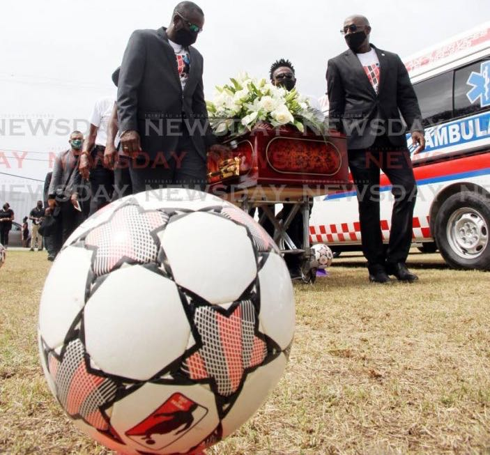Former Strike Squad members carry the casket of former team-mate Larry Joseph at his funeral, on Wednesday, at the La Brea Recreation Ground, La Brea. Joseph passed away on February 17. He was 56. - Lincoln Holder