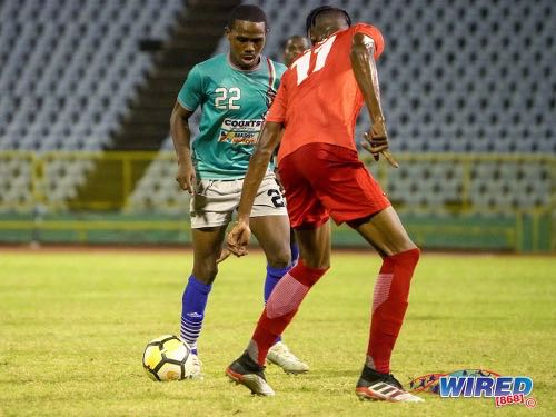 Photo: Morvant Caledonia flanker Joshua Alexander (left) runs at TLH Rangers defender Ross Russell Jr during Pro League action at the Hasely Crawford Stadium on 21 January 2020. (Copyright Daniel Prentice/CA-Images/Wired868)