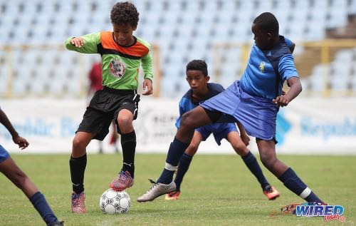 Photo: T&T Maestros midfielder Ocean Lindsay (centre) tries to pirouette past a FC Santa Rosa opponent during the RBNYL Under-13 final at the Hasely Crawford Stadium on 1 July 2017. (Courtesy Allan V Crane/CA-Images/Wired868)
