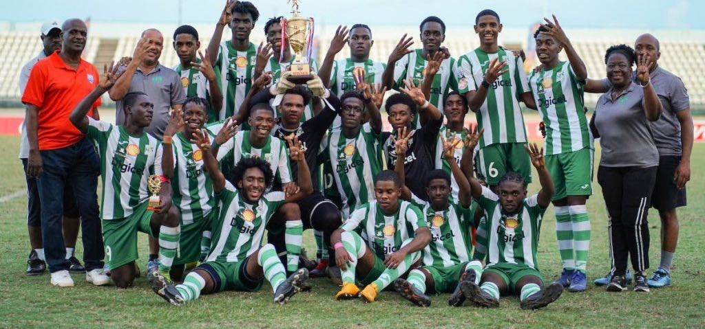 East Zone Intercol Champions San Juan North players and staff dsiplay the winners trophy after beating St Augustine 3-1 in the Coca Cola Intercol East Zone final, on Nov 21, at Larry Gomes Stadium, Malabar. - Daniel Prentice/CA-images