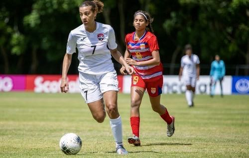 Photo: Trinidad and Tobago midfielder Sarah De Gannes (left) looks for a passing option during Concacaf U-20 Championship action against the Cayman Islands on 25 February 2020. (Copyright MexSport/Concacaf)