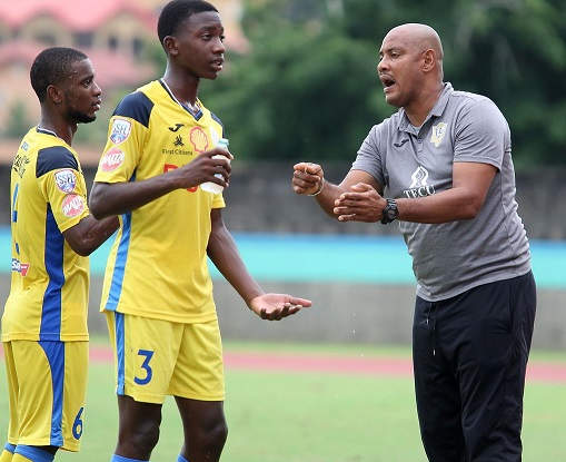 Shawn Cooper, right, the head coach of Presentation College of San Fernando gives instruction to his players Luke Charles, centre, and Zion Allen during their SSFL Premiership Division match at the Ato Boldon Stadium in Balmain, Couva on October 9. Presentation won 1-0. ...ANTHONY HARRIS