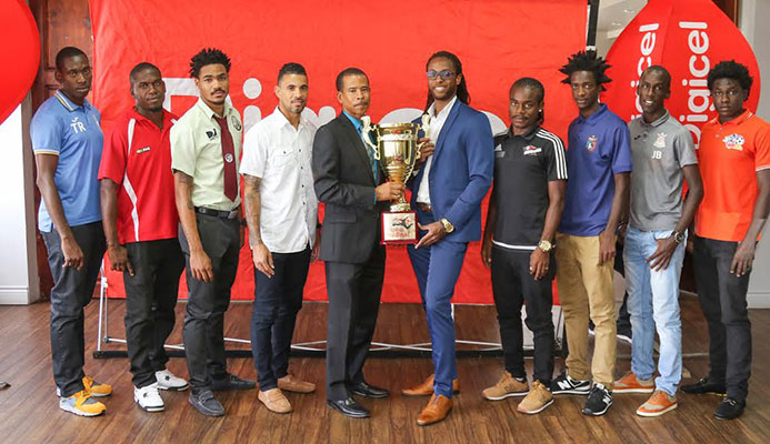 ​​Photo: Christopher Edmond, Senior Sponsorship Officer at Digicel (Trinidad and Tobago Limited), left of trophy, and Dexter Skeene, TT Pro League CEO, take centre stage with players during the launch of the Digicel Pro Bowl 2016/17 season edition at the VIP Lounge of the Hasely Crawford Stadium on Feb. 1, 2017.